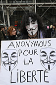 Protestor wearing Guy Fawkes mask of the Anonymous movement and based on a character in the film V for Vendetta, Paris, France - Stock Image - D1EB2M