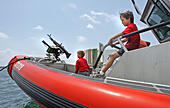051907 met coast guard Staff Photo Allen Eyestone/The Palm Beach Post --0038299A--Riviera Beach, FL..(left to right) Tyler Jimenez, 9, of Jupiter Farms and Zachary Wilbanks, 8, of Jupiter Farms, check out a 33-foot U.S. Coast Guard SPC-LE (special purpose craft - law enforcement). The craft is power - Stock Image - CFYHF0