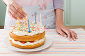 Woman with birthday cake - Stock Image - B7E7RF