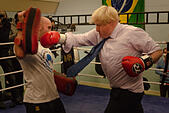London, UK. 28th October, 2014.  The Mayor of London, Boris Johnson, visits a training session at Fight for Peace Academy in Newham. Fight for Peace uses boxing and martial arts combined with education and personal development to realise the potential of young people in the borough at risk of crime and violence. First established in Rio in 2000 by Luke Dowdney MBE, it was replicated in Newham in 2007. It is now expanding globally and began rolling out across the UK. © Paul Davey/Alamy Live News - Stock Image - E9J2HA