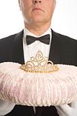 Butler Holding a Tiara on a Cushion - Stock Image - BDJCHE