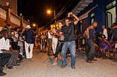 Music and dancing in the street, in the evening, Baracoa, Cuba - Stock Image - EAKDT9