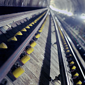 Newly laid trackwork on the Jubilee Line Extension, a part of London Underground's Tube network. - Stock Image - B8J332