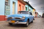 TRINIDAD: CLASSIC CAR ON COLOURFUL COLONIAL STREET - Stock Image - BXTG44