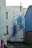 Bristol, UK. 21st Oct, 2014. A new work of art by street artist Banksy- called Girl With A Pierced Eardrum because of the alarm box where the earing is supposed to be - has appeared in Bristol overnight, and has been VANDALIZED. The artwork - a parody of Vermeer's Girl With A Pearl Earring - appeared in Hanover Place, behind the City's floating Harbour. ROBERT TIMONEY/Alamy Live News. - Stock Image - E96A6G