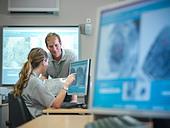 Forensic students examining fingerprints - Stock Image - CXWR0T