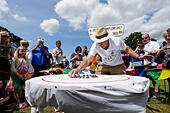 Congham, Norfolk, UK. 18th July, 2015. The World Snail Racing Championships. The Snail Master lines up competitors in the centre circle before racing commences © Action Plus Sports/Alamy Live News - Stock Image - EY01F5