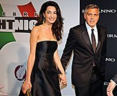 epa04389820 US actor-director George Clooney (R) arrives with his fiancee, British-Lebanese human rights lawyer Amal Alamuddin for the 'Celebrity Fight Night' at the Palazzo Vecchio in Florence, Italy, 07 September 2014. The charity event benefits the Andrea Bocelli Foundation and the Muhammad Ali Parkinson Center.  EPA/MAURIZIO DEGL'INNOCENTI - Stock Image - E79RJ5