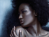 Beauty portrait of a young african american woman profile of face with shiny metallic skin - Stock Image - D270YG