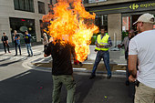 Brussels Belgium. 3rd October, 2014. picture shows a man who set himself on fire during a demonstration of refugees in Brussels, Friday 03 October 2014. Jonathan raa/Nurphoto © NurPhoto.com/Alamy Live News - Stock Image - E8BEYB