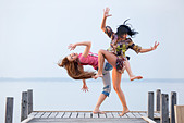 two girl  are dancing on background of water and sky - Stock Image - BRRR7M