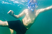 Teenager snorkeling in the water of Salto(Saltö) Sweden - Stock Image - BXXFKR