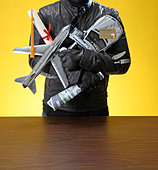 guy or thief holding all the things that he likes - Stock Image - BR3J84