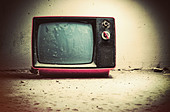 Old TV in room. Retro style colors. - Stock Image - CNM25K