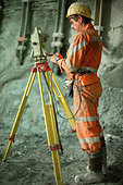 Construction site in the Gotthard Base Tunnel, a Vermessungsingeneur at work - Stock Image - CT814C