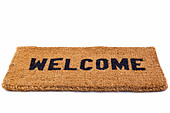 Photo of a welcome door mat isolated on a white background. - Stock Image - C4120H
