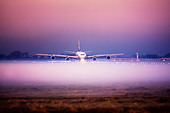 Airplane in the fog at London Heathrow Airport, UK - Stock Image - C3HC2P