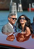 epa04418382 US actor George Clooney (L) and his fiance, Lebanese-British lawyer Amal Alamuddin (R) arrive in Venice, Italy, 26 September 2014. According to media reports, the wedding of George Clooney and Amal Alamuddin is to take place in Venice this weekend.  EPA/ALESSANDRO DI MEO - Stock Image - E82FCM