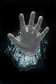 Open hand beneath water - Stock Image - DADT55