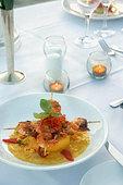 Shrimp entree on table - Stock Image - BAXC3Y