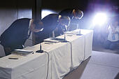 Tokyo, Japan. 21st July, 2015. (From L to R) Toshiba Chairman Tadashi Muromachi, President Hisao Tanaka and Executive Director Keizo Maeda bow during a press conference in Tokyo, capital of Japan, on July 21, 2015. Tanaka announced that he has resigned from his position for the accounting problem. © Stringer/Xinhua/Alamy Live News - Stock Image - EY3T41