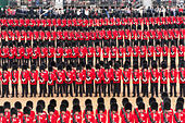 Horse Guards Parade, London, UK. 13th June, 2015. Divisions of Guards stand at ease. HRH The Queen takes the salute and inspects the parade at Trooping the Colour, The Queen's Birthday Parade. The Colour trooped this year is the 1st Battalion Welsh Guards in recognition of 2015 as the 100th anniversary of their founding. This large, colourful annual military display in central London includes foot and horse guards from the Household Division and with over 1,400 officers and men, 400 musicians and several hundred horses. © Malcolm Park editorial/Alamy Live News - Stock Image - ETF591