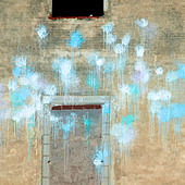 Front of empty building with spots of blue paint - Stock Image - CEGW0B
