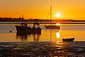 Swale Estuary, Kent, UK. 30th June 2015: UK Weather. A gorgeous orange glow as the sun rises into a clear, calm morning sky over boats moored in the Swale estuary near Harty Ferry. Hot air from Africa is set to sweep northward and take temperatures over 30°C on Wednesday with people warned to stay inside.© Alan Payton/Alamy Live News - Stock Image - EWPNAJ