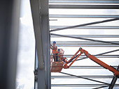 Construction workers in cherry picker - Stock Image - C70M35