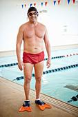 Man wearing swim gear at pool - Stock Image - CRKG5A