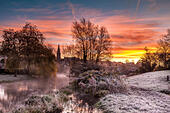 Malmesbury, Wiltshire, UK. 24th Nov, 2014. A heavy frost covers the watermeadow at sunrise in the Wiltshire hillside town of Malmesbury. © Terry Mathews/Alamy Live News - Stock Image - EB1HBB