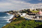 Coastal view of San Juan Peurto Rico with waves and beach in foreground - Stock Image - A5CW5H