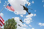 Tucson, Arizona, USA. 24th May, 2014. Apache helicopters fly over the interrment ceremony for Command Sgt. Maj. MARTIN BARRERAS in Tucson, Ariz. Barreras was wounded earlier in May after his unit came under fire in Herat Province, Afghanistan and died May 13, 2014 in Texas. Barreras is the most recent U.S. serviceman killed as a result of enemy action in Afghanistan. © Will Seberger/ZUMAPRESS.com/Alamy Live News - Stock Image - E16PYJ