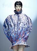 Beijing, China. 31st Oct, 2014. A model presents a creation designed by Hu Sheguang at Heyuanciye Hu Sheguang Collection during China Fashion Week in Beijing, capital of China, Oct. 31, 2014. © Chen Jianli/Xinhua/Alamy Live News - Stock Image - E9R8XY