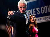 Florida, USA. 4th November, 2014. Nov. 4, 2014 - St. Petersburg, Florida, U.S. - CHARLIE CRIST throws a fist bump to supporters as he and wife Carole leave the stage after his concession speech at the The Vinoy Renaissance St. Petersburg Resort and Golf Club. (Credit Image: © Cherie Diez/Tampa Bay Times/ZUMA Wire/Alamy Live News) - Stock Image - EA0EGM