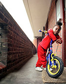 kevaniel. A young boy with his bicycle outside his home in an estate, Brixton, South London, UK, 2005 - Stock Image - BP7R9D