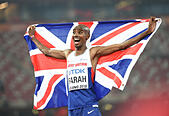 Beijing, China. 22nd August, 2015. Britain's Mohamed Farah celebrates after winning the men's 10000m final at the 2015 IAAF World Athletics Championships in Beijing, capital of China, on Aug. 22, 2015. (Xinhua/Li Gang) © Xinhua/Alamy Live News - Stock Image - F0X234