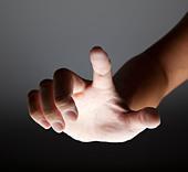 hand touching in the dark - Stock Image - C8PF84