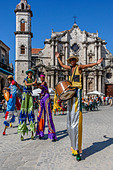 Street Entertainers Dancing On Stilts, Old Havana, Havana, Cuba - Stock Image - DN3XD6