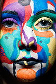 Close up of a girl's painted face - Stock Image - AYWCM8