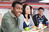School students having lunch - Stock Image - BCKK6A