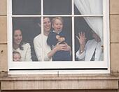Britian's Prince George is held by a nanny as he waves through a window of Buckingham Palace 13 June 2015 while the Royal Family head for Horse Guards Parade nearby for the annual Trooping the Colour ceremony to mark the monarch's official birthday. Photo: Patrick van Katwijk/ POINT DE VUE OUT - NO WIRE SERVICE - - Stock Image - ETJMTN