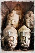 Asian sculptured heads - Stock Image - BM03RX