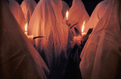 Women holding candles during an Easter Sunday Mass in the Catholic Church, Joyabaj, Guatemala - Stock Image - BG1T0K
