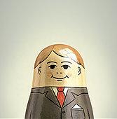 Happy, smiling businessman nesting doll - Stock Image - EF7FBF