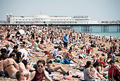 Brighton beach, Sussex, UK. 1st July 2015. Brighton beach is packed with sunbathers & swimmers as the UK enjoys a heatwave. - Stock Image - EWTXA8
