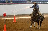 Fort Worth, Texas, USA. 29th Jan, 2014. Bobby Wilbanks on Docs Leo Dandy competes in mounted shooting at Justin Arena during the Fort Worth Stock Show and Rodeo on Wednesday, Jan. 29, 2014, in Fort Worth, Texas. © Khampha Bouaphanh/Fort Worth Star-Telegram/MCT/Alamy Live News - Stock Image - DRMYGD