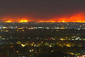 "Boise, Idaho, USA. 14th Aug, 2015. This photo was taken early August 14 nearly 50 miles from the  fire line which is 40 miles wide .  The ""Soda Fire"" is the largest wildfire burning in the continental United States.  The night view and the geography tend to compress the 50 mile distance. © David R. Frazier Photolibrary, Inc./Alamy Live News - Stock Image - F0EKNF"
