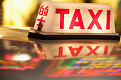 Neon signs and taxi light Tsim Sha Tsui Kowloon Hong Kong China - Stock Image - BDEB0T