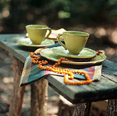 Coffee setting on a table in the open air - Stock Image - B471T7